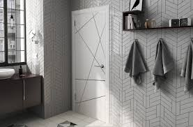 funky and playful bathroom wall rendition with tiles from