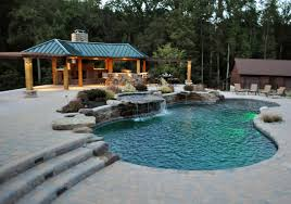 freeform pool waterfalls pavillion outdoor kitchen washington