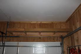 Build Wood Garage Cabinets by Shelves Over The Garage Door The Cavender Diary