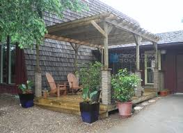 front porch and pergola with stone wrapped posts des moines deck