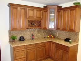 granite countertop white kitchen cabinets with white backsplash