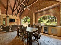 rustic porch with outdoor kitchen u0026 exterior stone floors in
