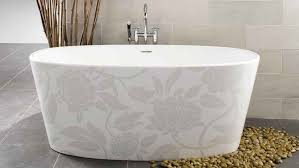 cream wall tile with oval stand alone bathtub on white ceramic