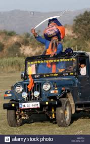 punjab jeep nihang sikh devotee perform martial skill while driving jeep on