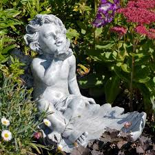 cherub blowing a resin garden ornaments