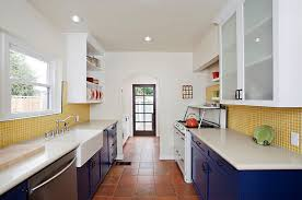 backsplash for yellow kitchen eclectic kitchen with blue cabinets and yellow tile backsplash for