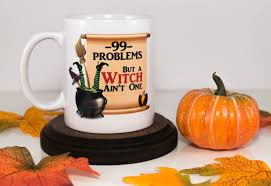 99 problems but a witch ain u0027t one halloween funny coffee mug cueve