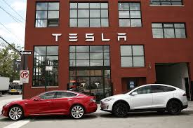 tesla dealership your future tesla will earn money by driving itself says elon