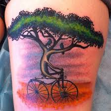 creative tree and bicycle design of tattoosdesign of tattoos
