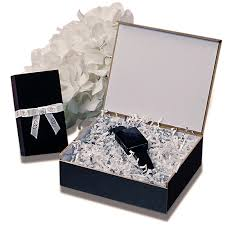 silver boxes with bows on top black hinged top wooden boxes