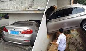 bmw hospital bmw driver ploughs car into hospital wall after pushing