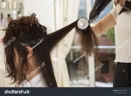 shaping long hair young woman hair salon drying shaping stock photo 473977756