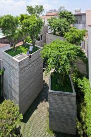 trees grow on rooftops of house by vo trong nghia architects