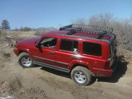 red jeep commander xk in the mud jeep commander forums jeep commander forum