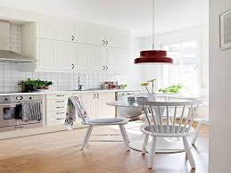contemporary scandinavian style kitchen design using glossy white finest swedish kitchen design london