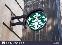 starbucks sign with company icon outside a coffee shop in new york