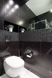 black toilet white toilet in modern black restroom stock photo picture and