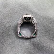 art deco emerald wedding ring and black anchor navy wedding band