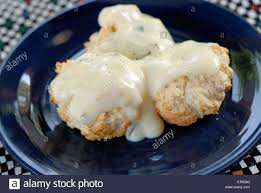 homemade drop biscuits covered in country style milk gravy and