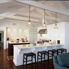 beach house dining room traditional with cream kitchen cabinetry