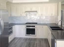 white kitchen cabinets with gray quartz counters antique white kitchen cabinet with grey quartz countertop