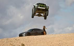 subaru rally jump watch b j baldwin jump a nissan gt r with a trophy truck photo