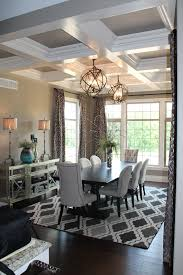 gray dining room features a tray ceiling accented with a satin