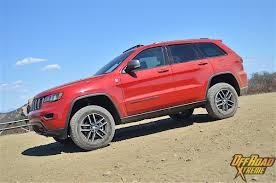 jeep grand cherokee all terrain tires getting dirty and going fast with jeep s 2017 lineup