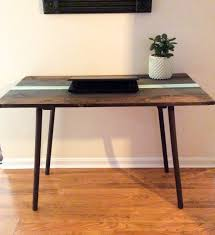 mid century modern wood desk with angled legs colorful laptop