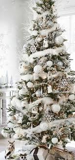 decorating white on white tree with woodland