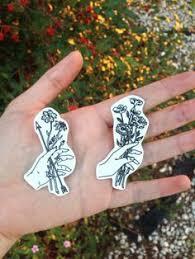 holding flower designs tats