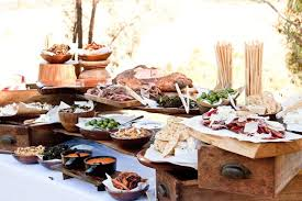 table canapé a rustic canapé table with wooden boards of charcuterie and bowls of