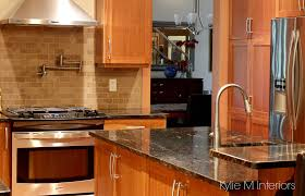 kitchen backsplash travertine cherry cabinets in kitchen with black granite prep sink