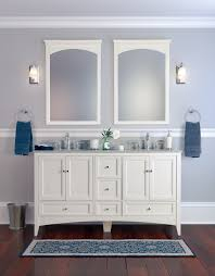 double white wooden wall mirror among unique wall lights attached