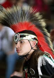 presentwearing a native american head dress kevin chavis of