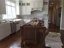 stained kitchen cabinets with hardwood floors the hardwood floors are finished minwax provincial stain