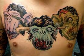nice evil monkeys head tattoo on chest by cheape