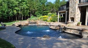 lagoon style pool with bubblers two story fireplace low