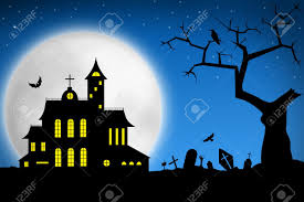 spooky halloween night tree on cemetery and haunted house against