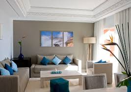 beige accent wall living room contemporary with beige sofa dark