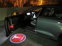 projector logo lights teslatap