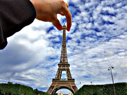 Pictures Of People U0027holding U0027 The Eiffel Tower Business Insider