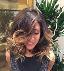 medium length dark brown hairstyles thick bouncy hickory brown hair with waves layers and caramel