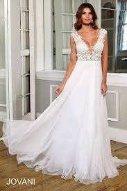 jovani wedding dresses white and floor length gown with a plunging sheer neckline