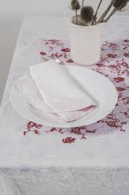 light pink paper dinner napkins pink dinner napkin on plate next to thistle plants stock photo