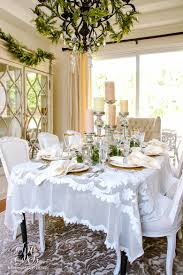 elegant white and gold christmas dining room and table scape