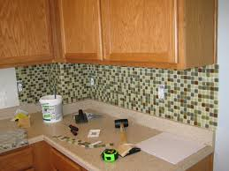 mosaic glass backsplash kitchen tiles backsplash hairy concrete counter black kitchen cabinet