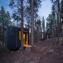 micro cabin invisible barn is a mirror clad cabin camouflaged among trees