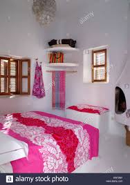 Bedroom Bed In Corner Bright Pink Bed Cover On Bed In White Moroccan Bedroom With Simple