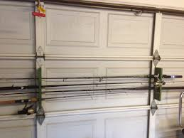 Diy Shelves Garage by Fishing Rod Holder Made From Pallet Wood And Hung On The Garage